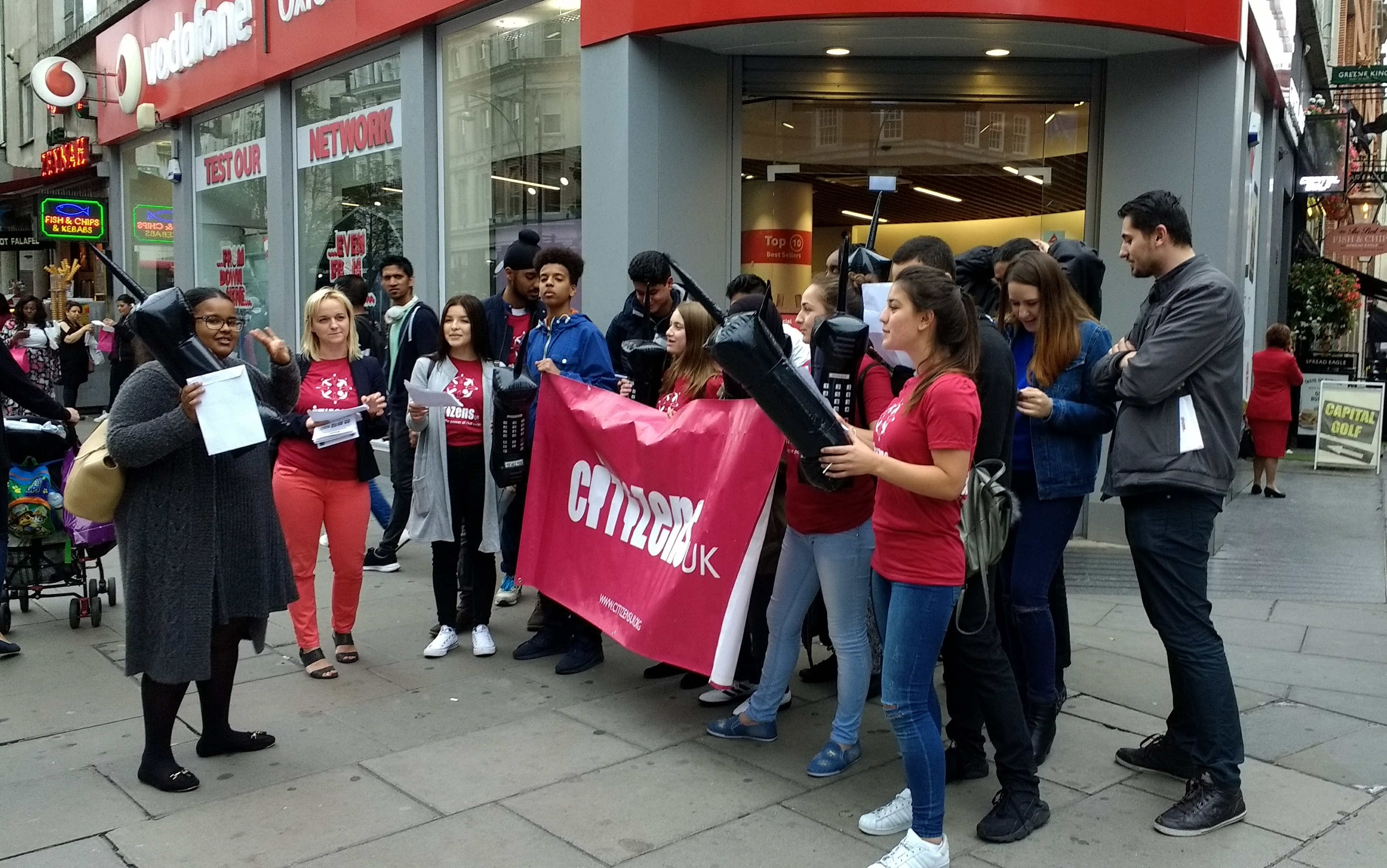 Citizens UK campaigning for Vodafone to stop funding hate